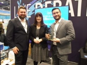 Liam Jones and Adam Cook receiving the award from Mary Dhonau OBE