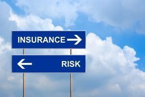Insurance and risk on blue road sign with blue sky
